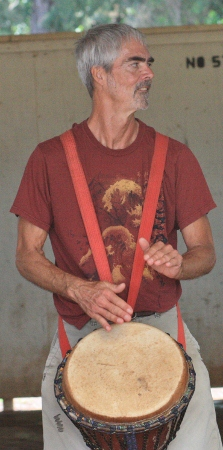 Nowick Gray playing djembe