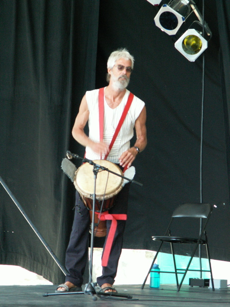 Nowick Gray playing lead djembe at Victoria Folk Festival